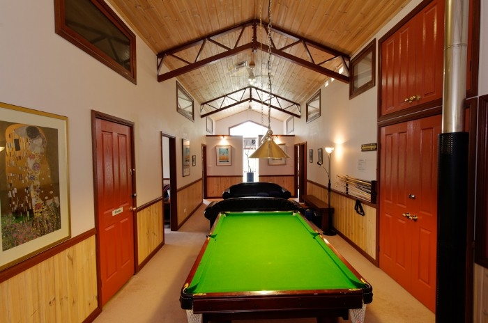 Upstairs pool table and lounges